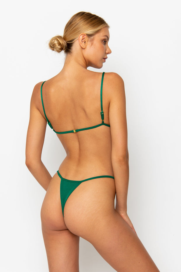 Sommer Swim Model facing backwards and wearing Uma bralette bikini top in emerald