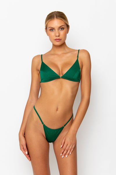 Sommer Swim Model facing forwards and wearing Uma bralette bikini top in emerald