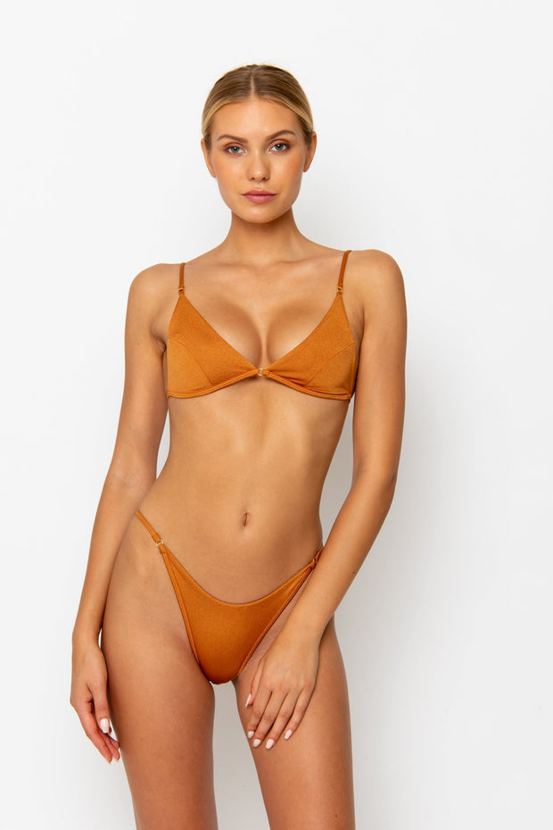 Somme Swim model facing forwards and wearing Uma bralette bikini top in papagayo