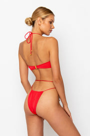 Sommer Swim Model facing backwards and wearing a Xena halter style bikini top in Venere