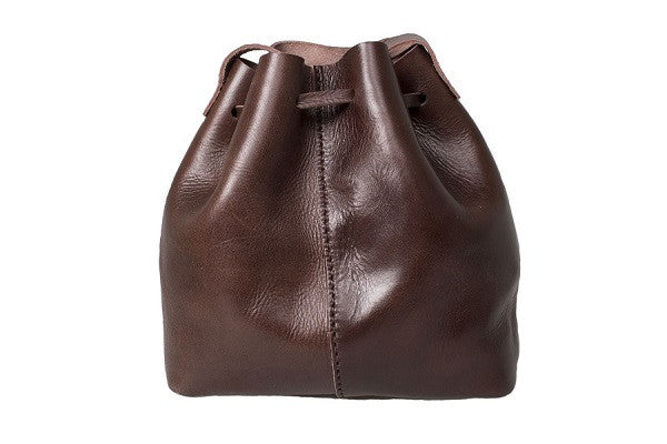 Curatelier Natalie Minimalist Vegetable Tan Leather Tassel Bucket Bag in Dark Chocolate (Medium) (Front View)