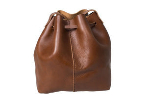 Curatelier Natalie Minimalist Vegetable Tan Leather Tassel Bucket Bag in Cognac (Medium) (Back View)