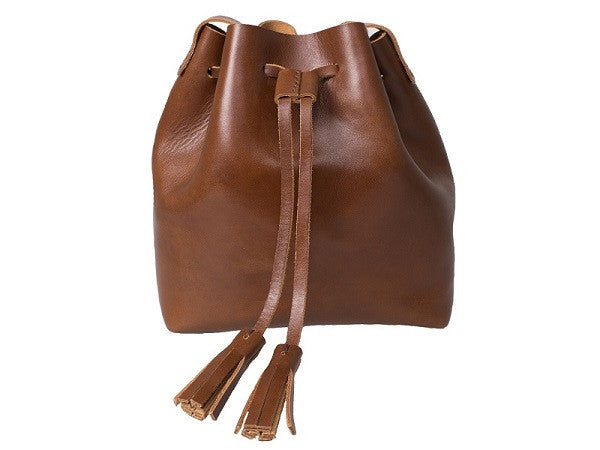 Curatelier Natalie Minimalist Vegetable Tan Leather Tassel Bucket Bag in Cognac (Medium) (Front View)