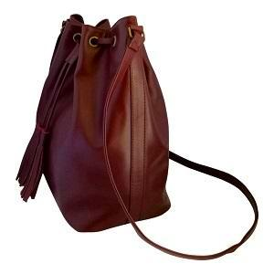 Velle Dahlia Medium Bucket Bag With Tassel Drawstring in Maroon Cow Leather (Side View)