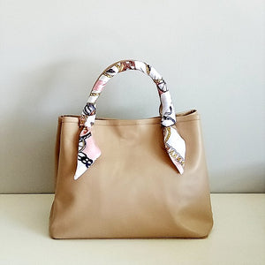 Curatelier Interlace Bag Handle Ribbon Scarf Featured on Velle Bella Rose Petite Tote Bag in Caramel