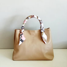 Load image into Gallery viewer, Curatelier Interlace Bag Handle Ribbon Scarf Featured on Velle Bella Rose Petite Tote Bag in Caramel
