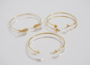 IOTC To The Point Arrow Plated Open Bangle in Gold Paired With Other Bangles (Front View)