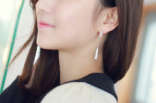 Load image into Gallery viewer, IOTC Waltz Pendulum Long Drop Crystal Earrings in Silver (Model View)