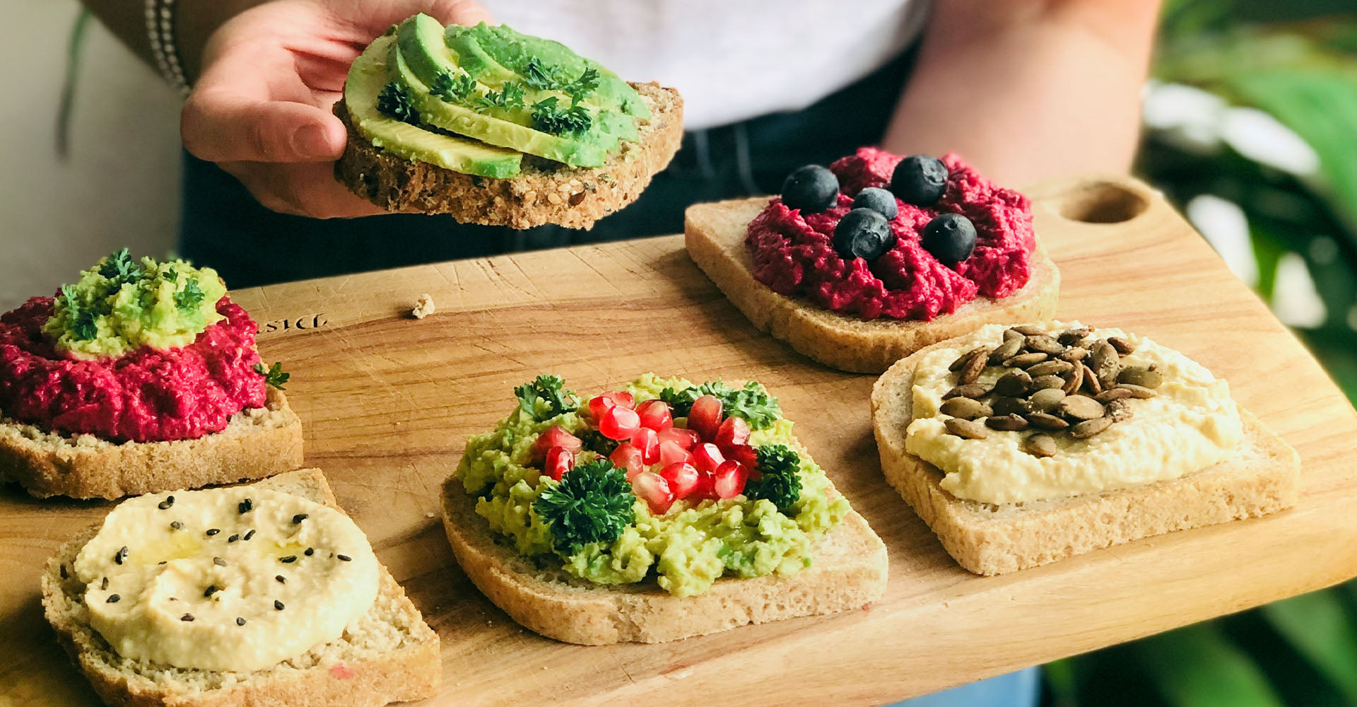 A board of toast topped with colourful ingredients