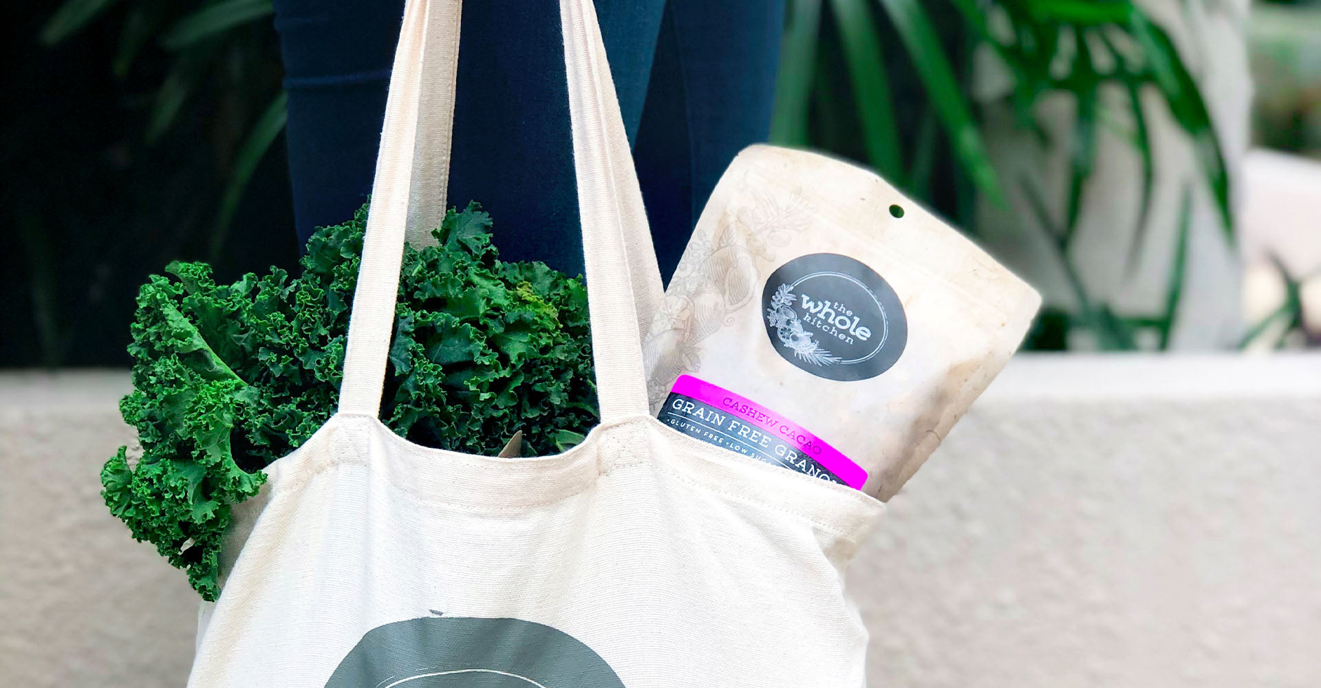 Tote bag full of greens and The Whole Kitchen granola