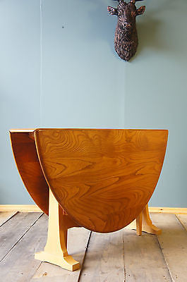 Ercol Elm Large Round Gate Leg Dining Table. - erfmann-vintage