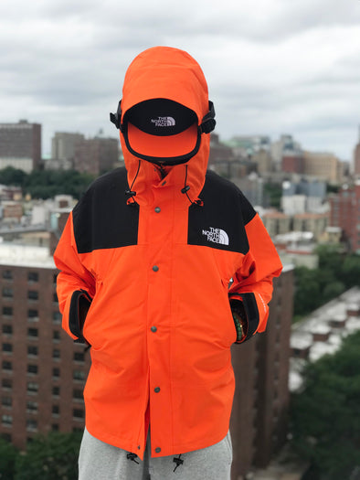 THE NORTH FACE M 1990 MOUNTAIN JKT GTX-PERSIAN ORANGE/TNF BLACK