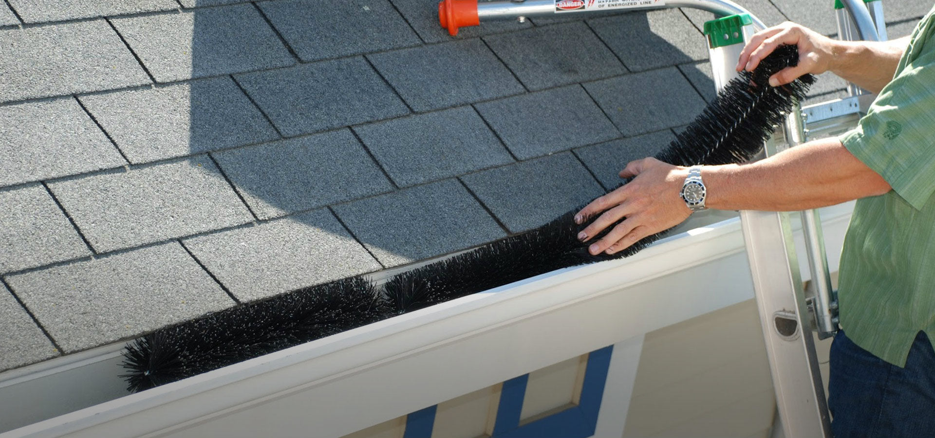 homeownser self installs gutter clog protection.
