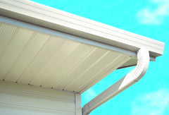 White Fascia rain gutter installed on building