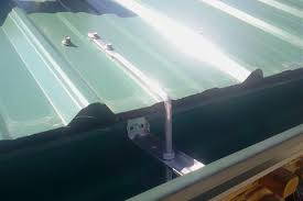 gutter hung frommetal roofing using rod and nut hangers and cross bars