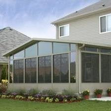prefabricated patio room is a challenge for a gutter screen