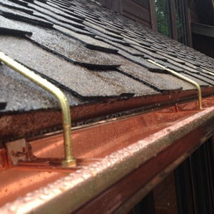 k style copper gutter hung from roof with rod and nut hangers
