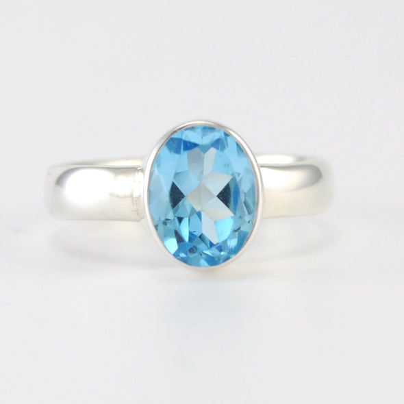 Silver Blue Topaz 7x9mm Oval Ring