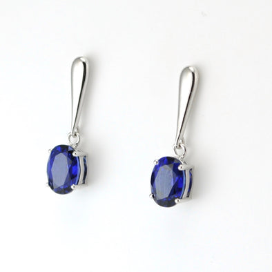 Silver Created Sapphire 3.3ct Oval Dangle Earrings