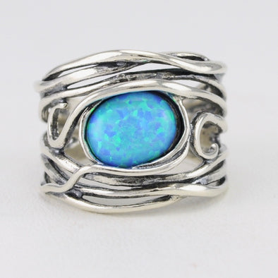Created Opal Oval in Wide Band Ring