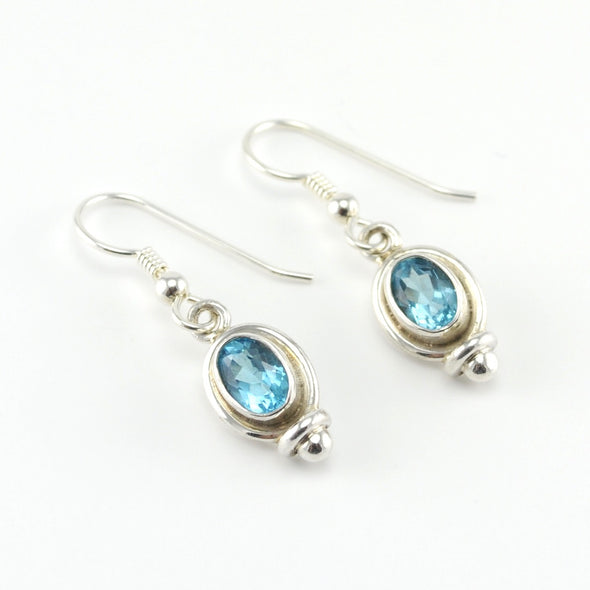 Silver Blue Topaz 5x7mm Oval Dangle Earrings
