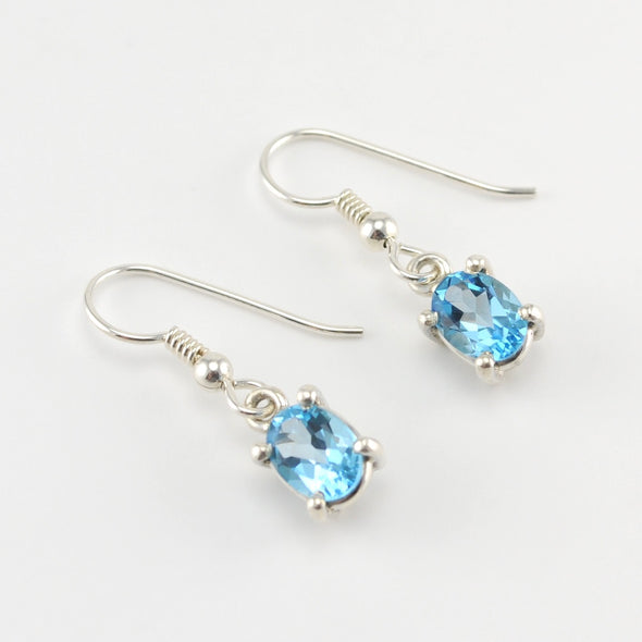 Silver Blue Topaz 6x8mm Oval Dangle Earrings