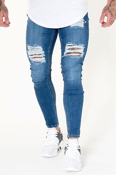Sinners Attire Ripped & Repaired Jeans Dark Wash