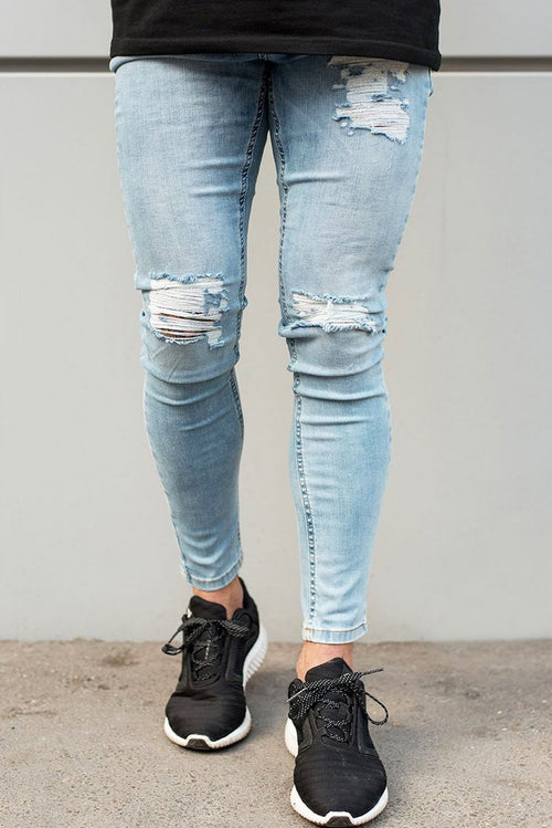 Sinners Attire Ripped & Repaired Jeans Light Blue