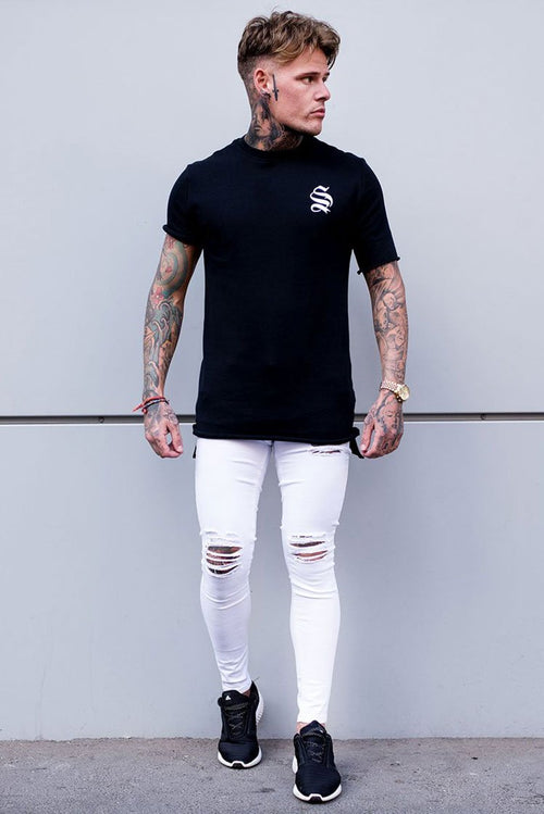 Sinners Attire Ripped & Repaired Jeans White