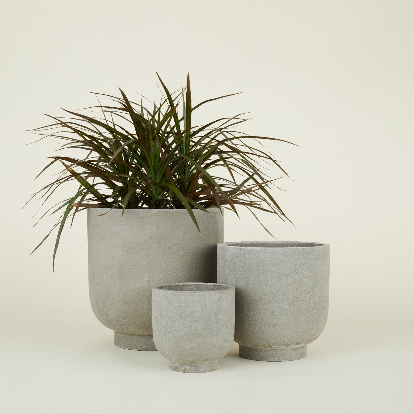 FIBER CEMENT FOOTED PLANTERS