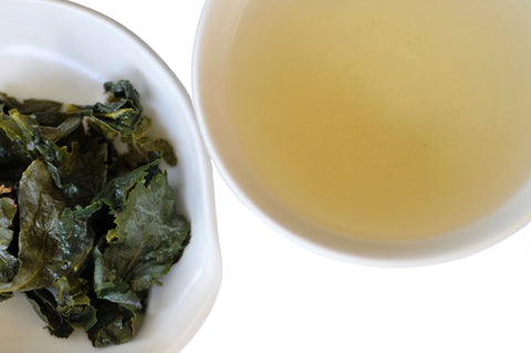 Tie Guan Yin wet leaves and tea liquor