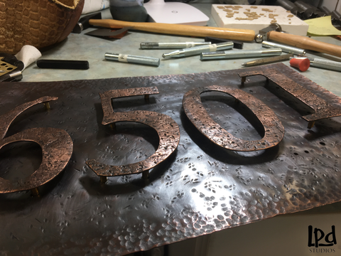 LPDstudios Blog: Custom Corner - Copper Metal Address Plaque. Once the numbers were affixed to the backing, and a clear coat was applied to the metal for protection, the plaque was ready to go to it's new home!