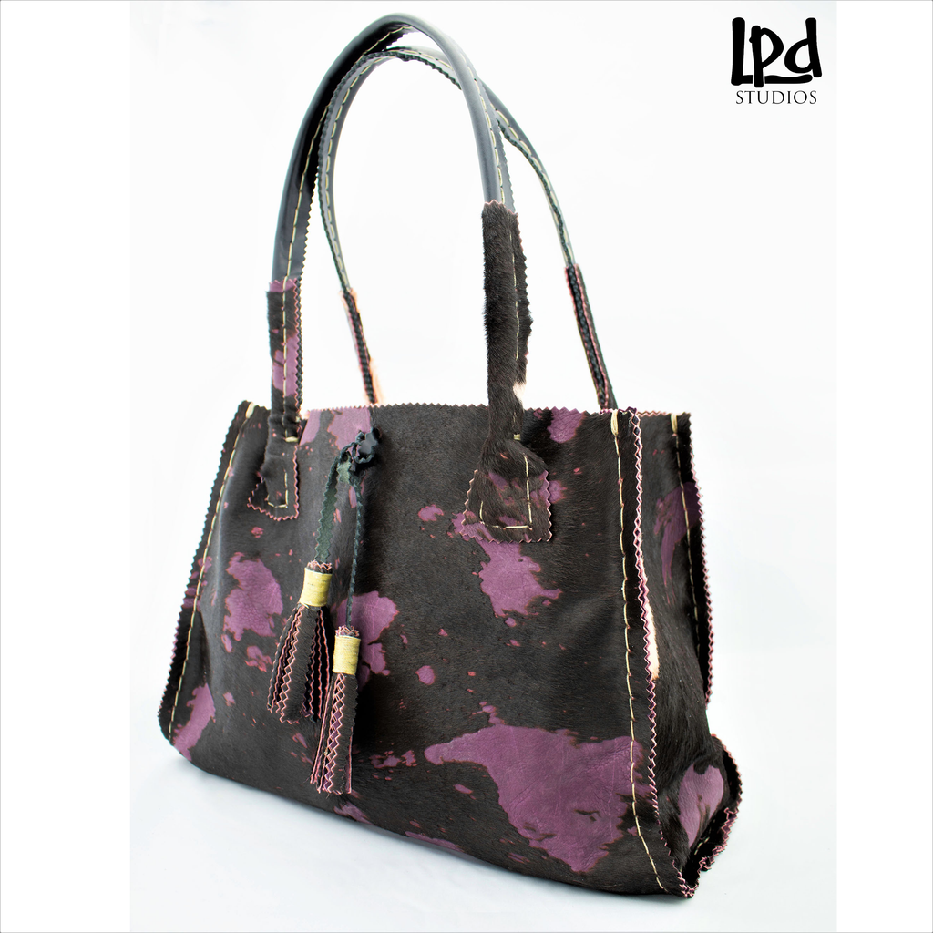 Overdyed Purple Plum Brindle Fur Leather Tote with Tassels - LPDstudios was created by designer artist Lisa Parmer Ditty. All of her designs are handcrafted in her Pennsylvania studio. She has merged her love of leather, metal and metal clay to create a unique collection of custom leather handbags, metal and leather jewelry and even pet collars. Follow her studio blog and see what she is designing next.