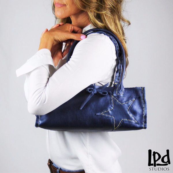 LPDstudios - Pearled Navy Blue Handsewn Leather Night Out Tote with Star - LPDstudios was created by designer artist Lisa Parmer Ditty. All of her designs are handcrafted in her Pennsylvania studio. She has merged her love of leather, metal and metal clay to create a unique collection of custom leather handbags, metal and leather jewelry and even pet collars. Follow her studio blog and see what she is designing next.