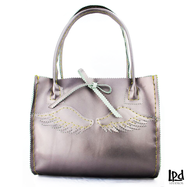 LPDstudios Metallic Lilac Purple Leather Purse with Pegasus Wings - LPDstudios was created by designer artist Lisa Parmer Ditty. All of her designs are handcrafted in her Pennsylvania studio. She has merged her love of leather, metal and metal clay to create a unique collection of custom leather handbags, metal and leather jewelry and even pet collars. Follow her studio blog and see what she is designing next.