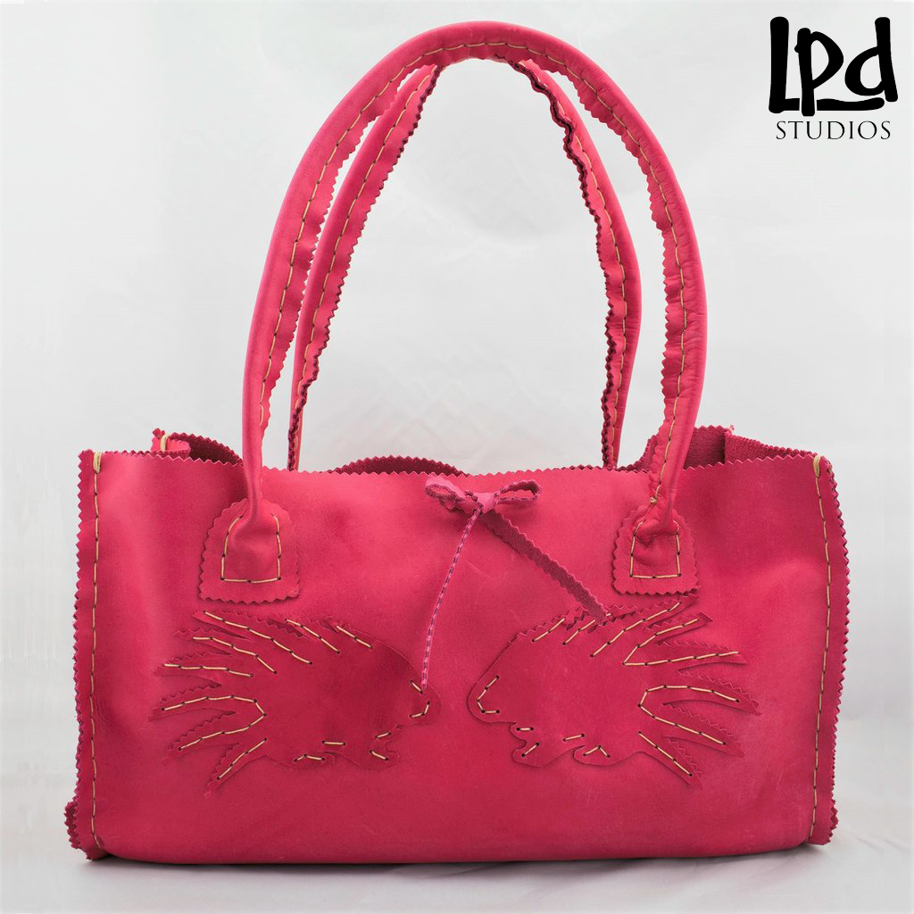 LPDstudios - Lipstick Pink Nubuck Leather Purse with Porcupines - LPDstudios was created by designer artist Lisa Parmer Ditty. All of her designs are handcrafted in her Pennsylvania studio. She has merged her love of leather, metal and metal clay to create a unique collection of custom leather handbags, metal and leather jewelry and even pet collars. Follow her studio blog and see what she is designing next.