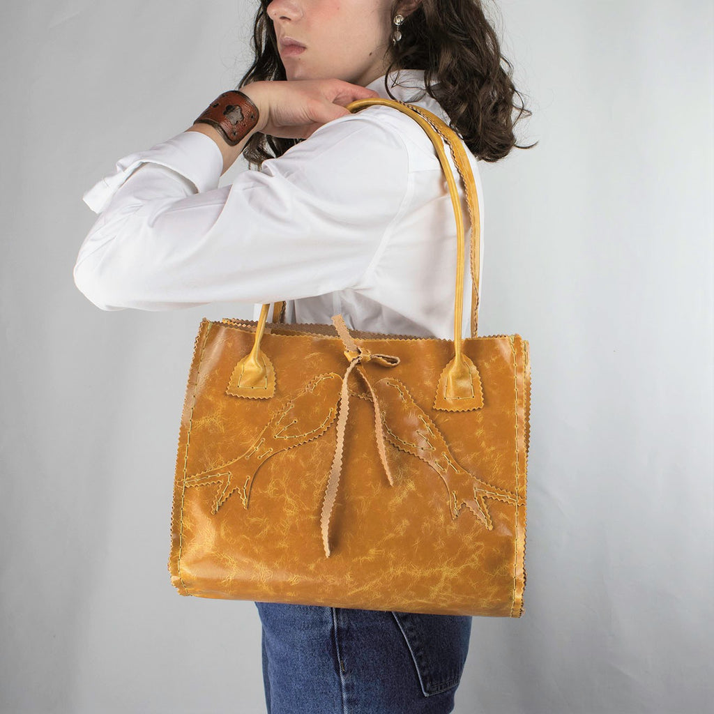 Distressed Honey Brown Leather Bag with Mirrored Bird Motif