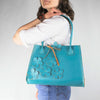 Robins Egg Blue Purse with a Scattered Floral Design