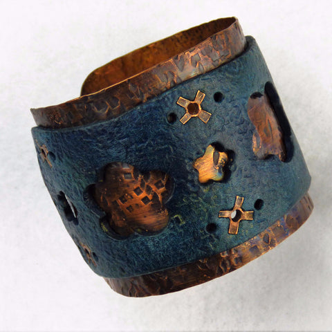 Distressed Copper Leather Cuff with Floral Cut Outs and Hand Cut Rivets