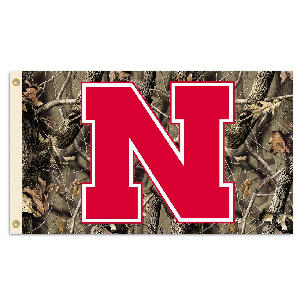 NCAA Officially licensed products Nebraska Huskers 3 Ft. X 5 Ft. Flag W/Grommets - Realtree Camo Background Show everyone th