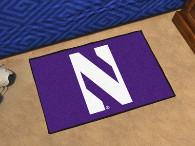 "NCAA Officially licensed Northwestern University Starter Mat 19""x30"" Start showing off your team pride at home and the offic"