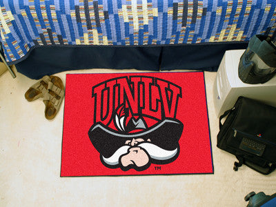 "NCAA Officially licensed University of Nevada, Las Vegas (UNLV) Starter Mat 19""x30"" Start showing off your team pride at hom"
