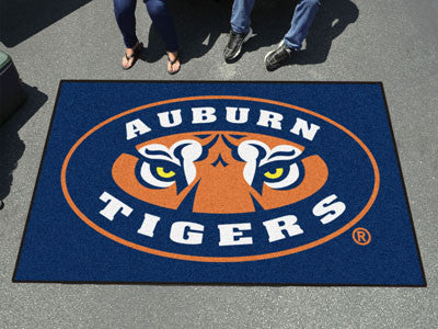 "NCAA Officially licensed Auburn University Ulti-Mat 59.5""x94.5"" Start showing off your team pride with an Ulti-Mat from Spor"