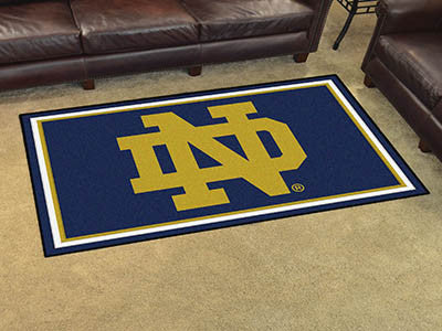 "NCAA Officially licensed Notre Dame 4x6 Rug 44""x71"" Show off your team pride in a big way! 4'x6' ultra plush area rugs won't"