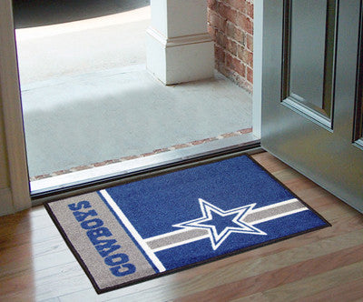 "NFL Officially licensed products Dallas Cowboys Uniform Starter Rug 19""x30"" Start showing off your team pride at home and th"
