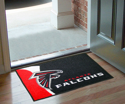 "NFL Officially licensed products Atlanta Falcons Uniform Starter Rug 19""x30"" Start showing off your team pride at home and t"