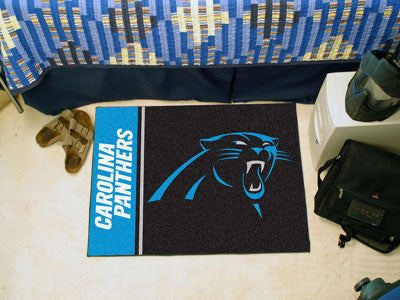 "NFL Officially licensed products Carolina Panthers Uniform Starter Rug 19""x30"" Start showing off your team pride at home and"