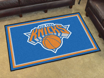 NBA Officially licensed products New York Knicks 5'x8' Rug Show off your team pride in a big way! 5'x8' ultra plush area rug