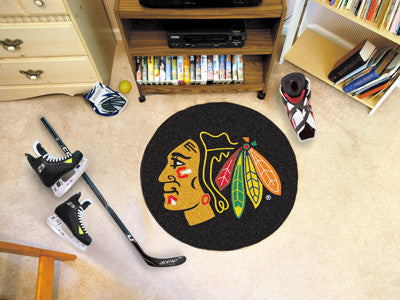"NHL Officially licensed products Chicago Blackhawks Puck Mat 27"" diameter  Protect your floor in style and show off your fan"