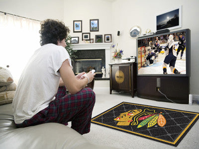 NHL Officially licensed products Chicago Blackhawks 4'x6' Rug Show off your team pride in a big way! 4'x6' ultra plush area